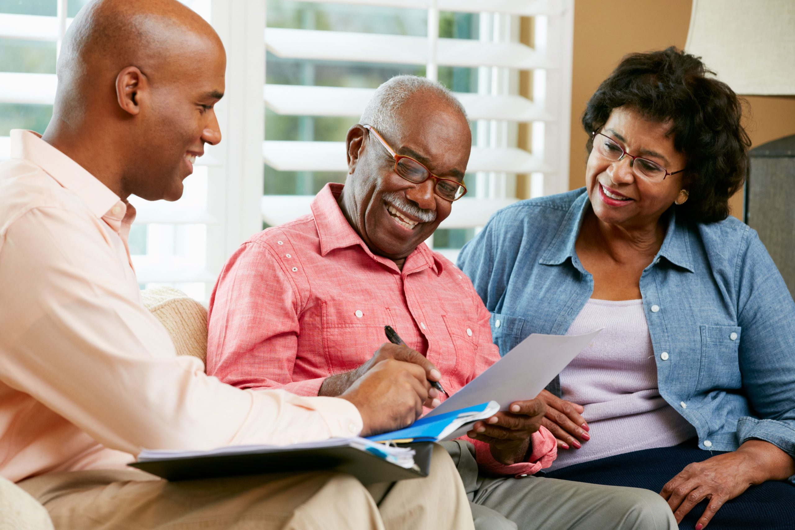 A young man helps his parents apply for a funeral policy. Funeral cover for parents can be an add-on benefit of your own funeral policy. Ask your insurer about the basics of your funeral policy today.