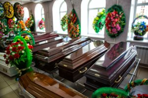 With a funeral insurance policy, your family can afford to give you a dignified funeral with the polished coffins and artful and colourful floral arrangements in this funereal home.